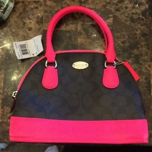 Coach satchel with neon pink